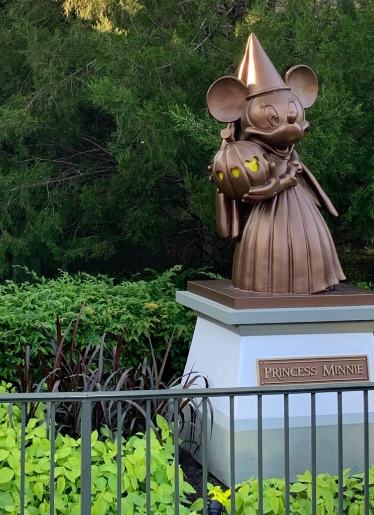 Bronze Princess Minnie Mouse Statue holding a pumkin