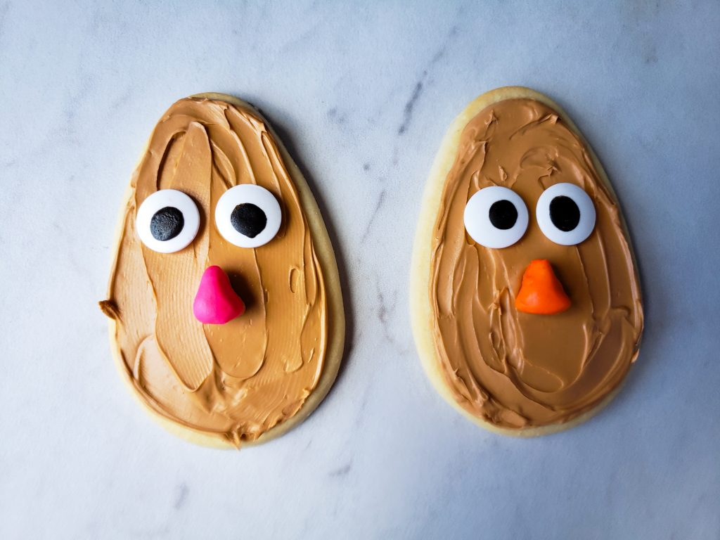 Mr. and Mrs Potato Head Cookie in progress with eyes and nose