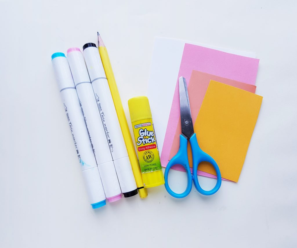 Scissors, markers, paper and glue stick